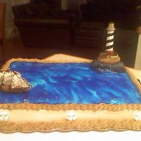 "Papa's Birthday Hand sculpted nautical themed cake. Rocks are from cake and ""painted"" with buttercream icing. Ocean is tinted piping gel. Life..."