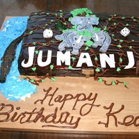 Jumanji Birthday Cake Red Velvet cake with fudge frosting. Everything you see on this cake is edible. All the figures were sculpted out of marzipan and painted...