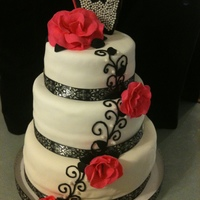 Black And White With Hot Pink Accents My first attempt at a wedding cake. Flowers are gumpaste, accents are buttercream on white fondant.