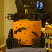 Haunted House Buttercream icing with royal icing accents. House, gate and grave stones are royal icing.