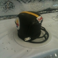 Steelers Football Helmet Red Velvet cake with cream cheese frosting. Grooms cake for a wedding. First time really carving anything like this. Struggles with the...