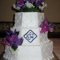 Octagonal Wedding Cake It was super humid the day I delivered this cake, so the purple monogram dripped down the front. I fixed the best I could, but you can...