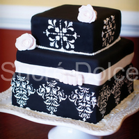 Damask Cake   Tuxedo cake with Whipped Chocolate Ganache filling, decorated in black fondant and white royal icing.