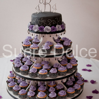 Purple And Black Wedding Cupcake Tower  Wedding Cupcake Tower. Tuxedo Cupakes filled with Whipped Chocolate ganache and topped with Vanilla Bean buttercream, and White Velvet...