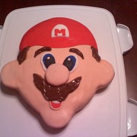 Mario Birthday Cake I made this Mario cake for my sons 2nd birthday since he is in love with Mario. Its all a freehand cake and covered in fondant from wilton...