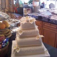 Wedding Cake This was my first wedding cake and first time making a 4 tier. While it isnt perfect, the bride and groom loved it and that was enough to...