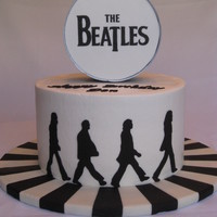 "The Beatles - Abbey Road  Birthday cake for a fan of The Beatles.Buttercream, 10"" round, 3 layers (6"" high). Fondant Beatles silhouettes. Fondant covered..."
