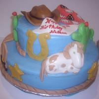 Western Theme Cake Butter cream icing with fondant decorations for a 5 year old boy.