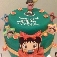 Dora And Kailan BIRTHDAY CAKE FOR MY NIECE SHE LOVES KAILAN AND DORA SO MERGED THEM BOTH ON THIS CAKE AS BEST AS I COULD. USED FONDANT AND EDIBLE PRINTS