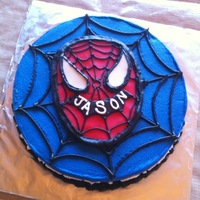 Spider Man Buttercreme covered and detailed in Buttercreme. The Spider Man face was red colored fondant.
