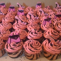 Hand Bags And Shoes Galore! Zebra print cups with hot pink buttercreme frosting topped with high heels and hand bags and black sprinkles!
