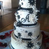 Black And White Wedding   Black and white gumpaste daisies on a buttercream cake