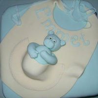 Christening Cake Rich chocolate cake decorated with fondant. Bib design with little teddy in the pocket.
