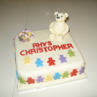 Teddy Bear Christening Cake Rich chocolate cake decorated with fondant.
