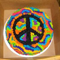 Peace/tye Dye Cake   I had alot of fun making this cake. The icing is white chocolate butter cream and the cake in vanilla.
