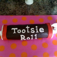 Moms Tootsie Roll Birthday Cake  Tootsie roll cake is made with yellow cake and chocolate butter cream. The outside of cake is made with MMF. My first time making fondant!...