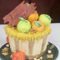 Appel Barrel Cake   This is a cake i did for a cake sculpting class. The apples are rice crispy treats. The cake is spice cake with buttercream filling.