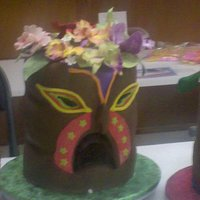 Tiki Cake This was a cake i did for a class. The flowers are gum past orchids.