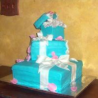 "Tiffany Boxes This was for a ""Sweet 16"" party. My first ""Gift Boxes"" cake and my first bows. Bows are MMF/Gumpaste I think they were..."