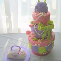 1St Birthday 1st birthday for my niece, also made the pirate ship for the same party (nephew's). MMF w/ some gumpaste on bow. Purse on top is RKT....