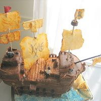 "Pirate Ship Cake base w/ MMF and pastillage for sails,posts& plank. RKT for raised decks. Gumpaste pirate & canons. Roughly 8""w x 13""..."