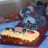 Wine Loving Dog My father-in-law's 90th birthday cakes. Dog is all cake. Crate is cake, bottle is rice krispies. Sadly my FIL suffers from short term...