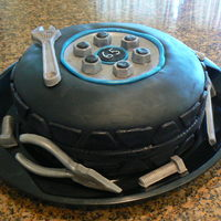 Tire Cake This cake is 100% edible. The tire is made from 2 10 inch rounds that I just shaped to a tire. The tools, nuts and screws are 100% edible...