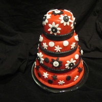 Black, Red & White Birthday Cake This is a mini tiered real cake.The bottom is a 6 inch, the 2nd tier is 5 inch, 3rd tier is a 4 inch, and the top tier is a 3 inch. This...