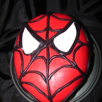 Spiderman Cake This is 2-10 inch cakes that I stacked on top of each other and then carved. The cake is covered in fondant with fondant webs and eyes. We...