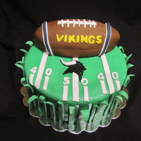 "Vikings Football Cake This is a 12"" x4"" birthday cake that I made. The football is a 9""cake that I carved into a football shape and covered with..."