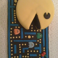 Pac-Man 2.0   Here is the latest version of my pac-man cake! It keeps getting better. Hope u enjoy! .....MACMACMACMACMAC (pacman noise - LOL)!