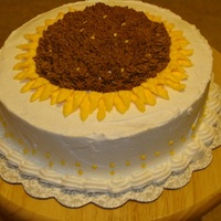 Sunflower Cake Lemon Buttercream Cake is Lemon with Lemon buttercream. I took the crown that is cut off to level the cake and added it to the center of the sunflower to...