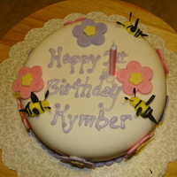 Kymbers First Birthday Cake Friend wanted her daughters 1st birthday cake with big flowers and bees because her daughter loves bees ! MMF with French Vanilla cake ....