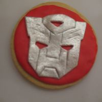 Transformer Cookie   NFSC covered in MMF Transformer logo done in MMF I cut out each one individually then painted it in luster dust