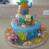 Sponge Bob Square Pants Cake for my son's birthday. Bottom layer marble top layer chocolate. Covered in MMF, RI coral reefs, plastic figures and some just...