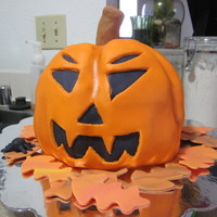 Jack O Lantern Pound cake with buttercream frosting covered in fondant. Happy Halloween!