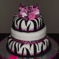 Zebra Striped Birthday Cake  I made this cake for my daughters 18th Birthday It is a 3 tier round covered with white fondant and black fondant zebra stripes I made all...