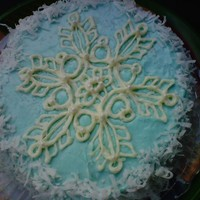 Snowflake Cake 8- inch double layer-Yellow Almond Cake, with Almond and Vanilla Blue Pastel Buttercream. White Chocolate Snowflake and coconut. Made this...