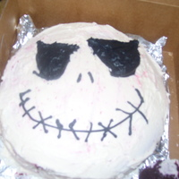 Jack Skellington 21St Birthday Cake   red velvet cake, cream cheese icing, face piped in black
