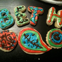 Paisley Print Cookies   Sugar cookies with royal icing decorated to match gift tin.