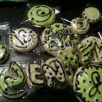 Green And Black Polka Dot Cookies   Sugar cookies with royal icing decorated to match gift tin.