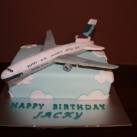 Cathay Pacific Airplane   Body of plane is RKT with gumpaste wings. Cake itself covered in fondant.