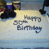 Kathy's 50Th Birthday 1/2 Sheet cake, flowers are silk.