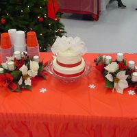 Michelle's Wedding Cake 8 inch and 6 inch white cake with buttercream frosting. Bow is fabric with red ribbon around the bottom. My first offical wedding cake made...