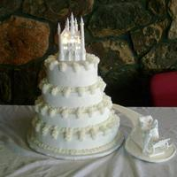 Lipford Wedding Four tired white cake with chocolate, strawberry, lemon and buttercream filling. As seen in Wilton's Yearbook.