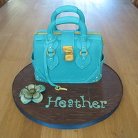 Teal Handbag Cake My first attempt at a handbag cake! Really enjoyed doing it although I desperately need to invest in a proper stitching tool!!