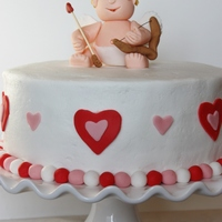 Cupid Cake  This was my first attempt at making a fondant/gum paste figure. It turned out pretty well... except my cupid could use a little liposuction...