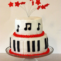 Music Cake   8 in and 6 in WASC cake, buttercream icing, with fondant and gum paste accents.