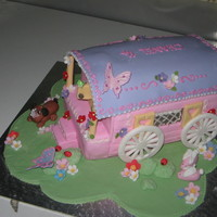 Gypsy Caravan caravan made from vanilla cake and everything else from fondant