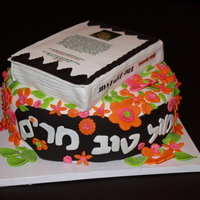 Book In A Garden This cake was for a bat mitzvah girl that is a writer. She is currently writing a book, so I made a cake with the book (as if she finished...